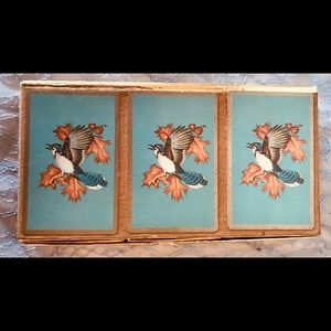 Boxed set of three decks of vintage playing cards